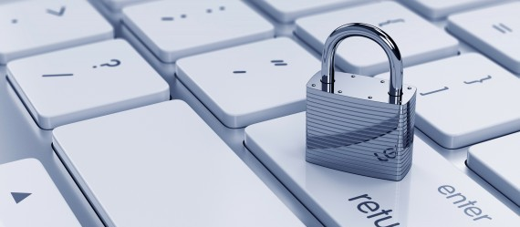 Picture of padlock on a white keyboard.